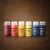 rainbow of stockman watercolour paint pigments on a wooden background