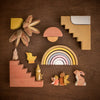 flat lay including Raduga Grez blocks and rainbow Holztiger wooden animals and Sweet Elm waldorf fairies and gnomes