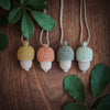 Australian wooden acorn necklaces in mustard copper and eucalyptus colours