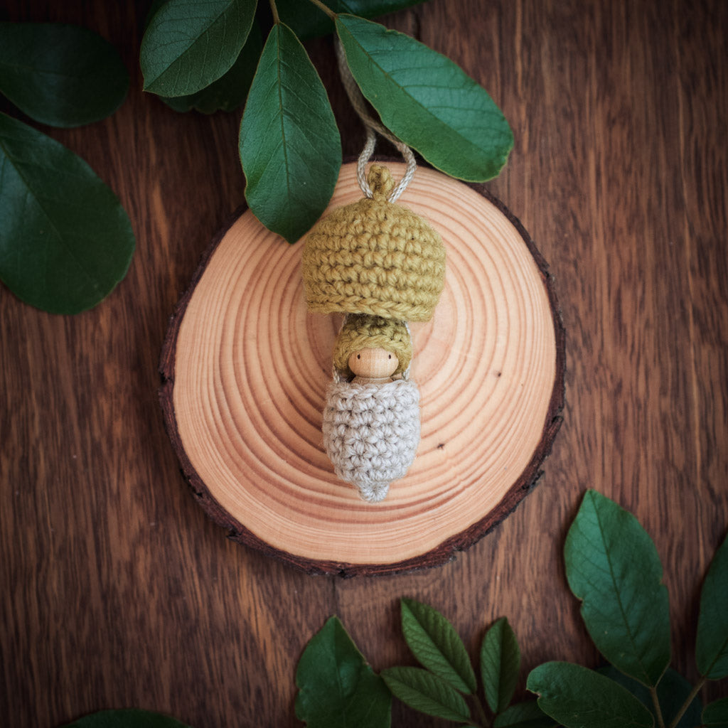 Steiner wooden acorn doll necklaces in colours of the Australian bush with gumnut babies peeping out
