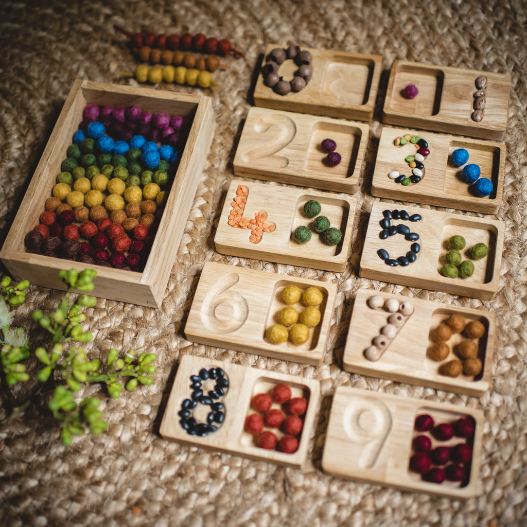 wooden number tray numeracy development with colourful felt balls