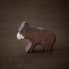 holztiger brown bear cub wooden animal toy in side profile view