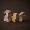wooden baby bunny toy animals from Holztiger handmade and sitting with a chick