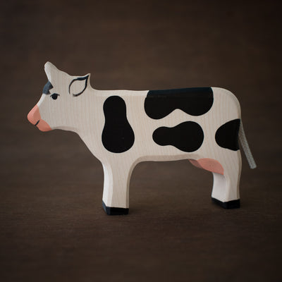 holztiger wooden cow toy from side