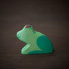 side view of green holztiger wooden animal toy