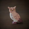 holztiger wooden owl from side
