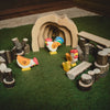 holztiger wooden rooster toy in play scene with branch blocks and Gluckskafer Grotto and other chickens