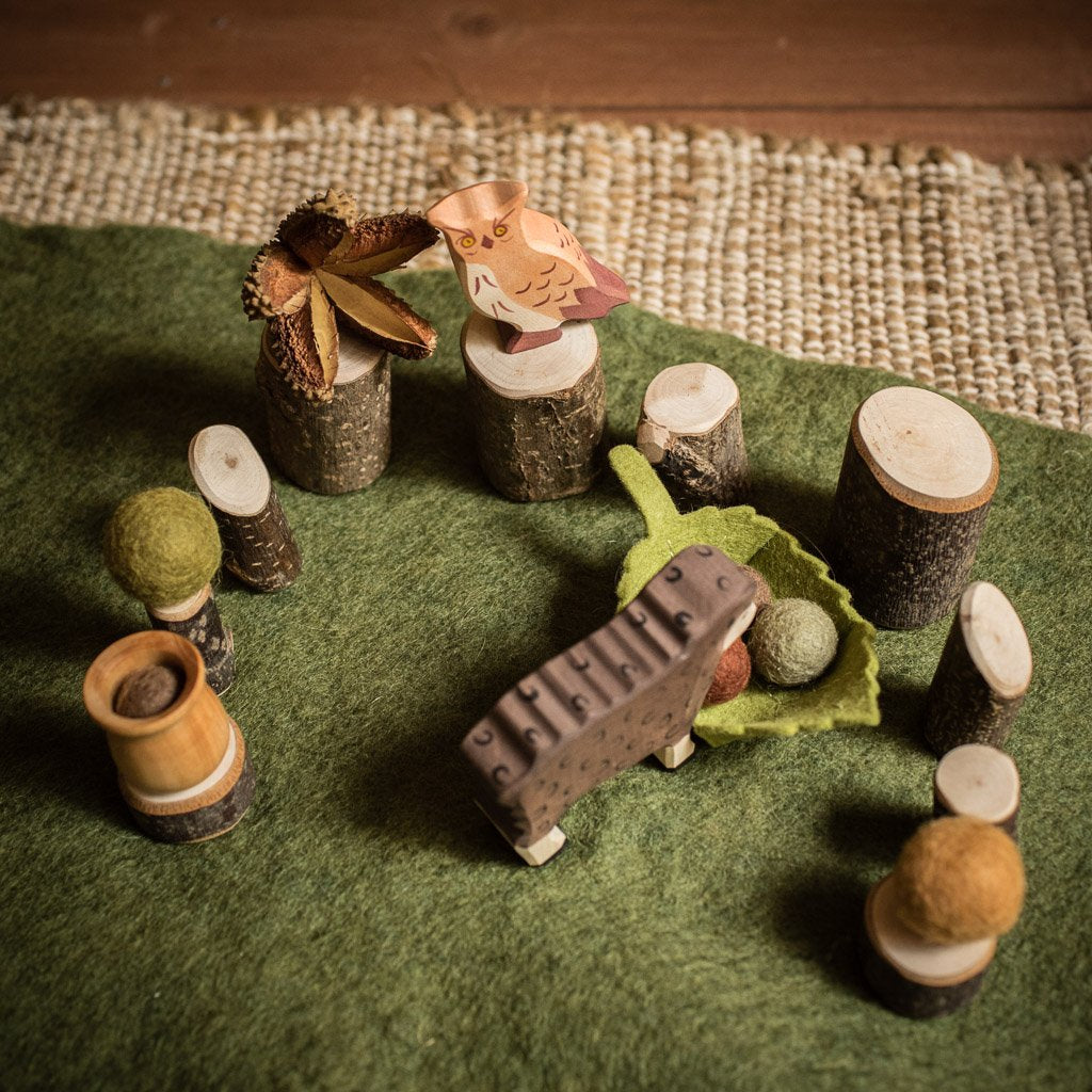 sweet elms loose nature parts in a basket with felt balls and teak seed pods