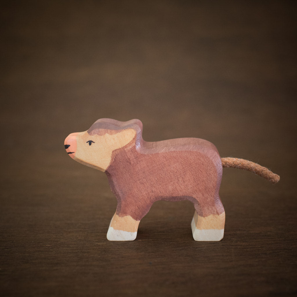 Side view of wooden holztiger highland cattle calf animal toy.