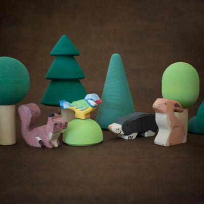 forest play scene with holztiger wooden squirrel, bird, mole and rabbit with Raduga Grez tree toys
