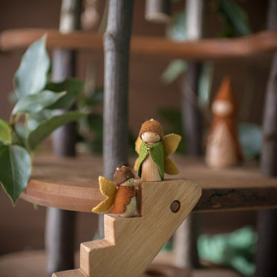 sweet elm fairy wooden doll toys on stairs of magic wood tree house