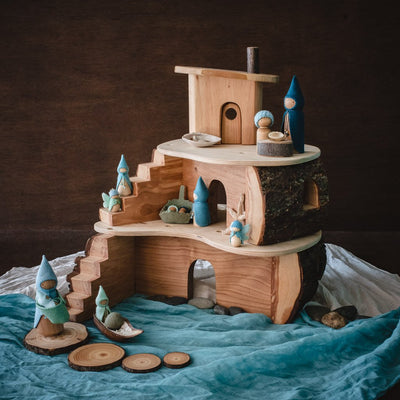 magic-wood-tree-house-on-blue-play-cloth-with-seaside-wooden-gnomes