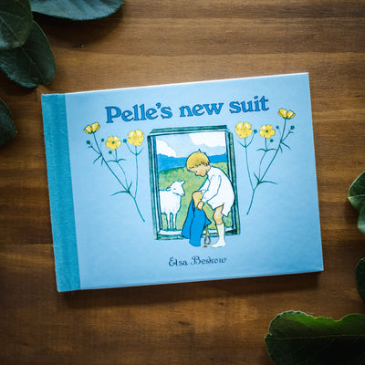 Pelle's New Suit front book cover on a wooden background
