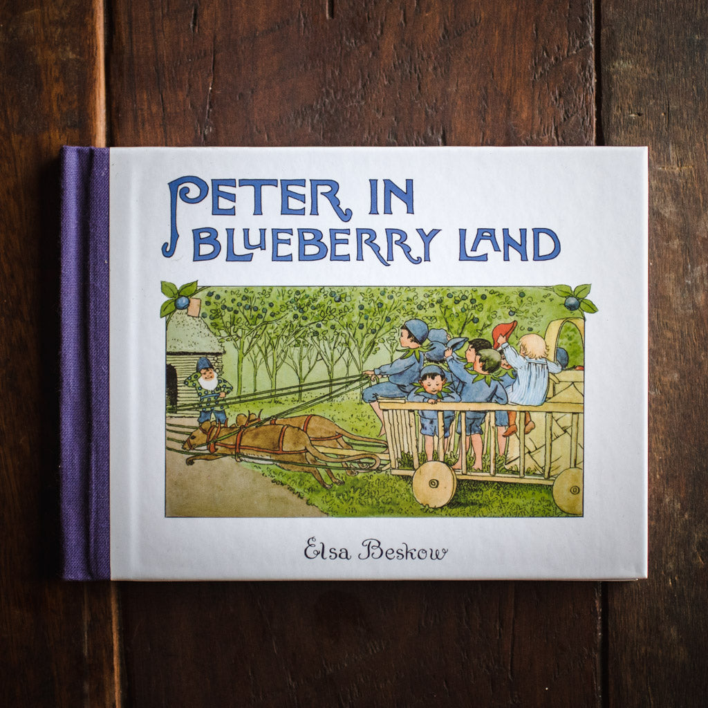 Front cover of Peter in Blueberry Land, featuring children riding in a wagon that's pulled by mice.