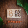 the number eight wooden number tray with gum nuts and rust felt balls