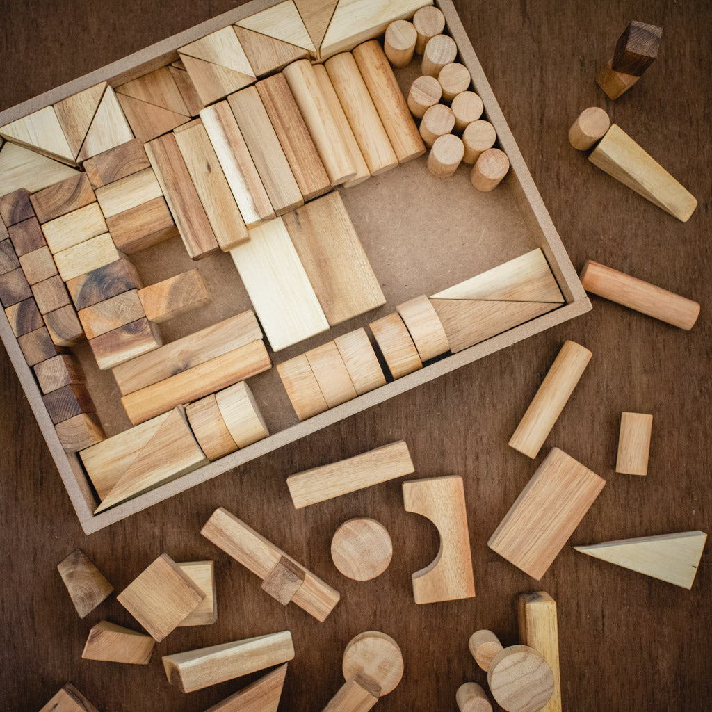 Natural Qtoys building blocks in a tray.