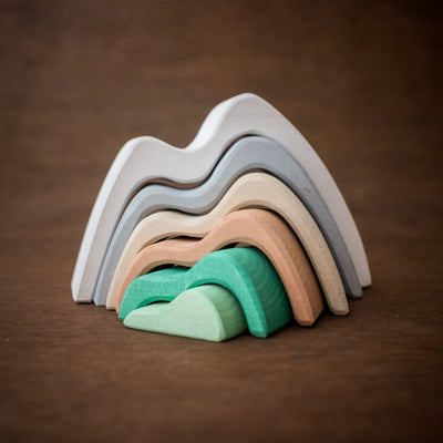 Raduga Grez wooden mountain stacker in green brown and grey curved