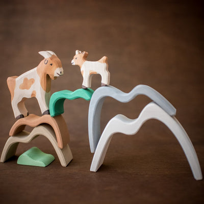 Raduga Grez wooden mountain stacker in green brown and grey with holztiger goats
