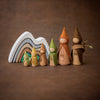 Raduga Grez wooden mountain stacker in green brown and grey with Sweet Elm gnome dolls