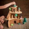 Raduga Grez wooden forest tree set with Magic Wood Tree House and child playing with Sweet Elm dolls