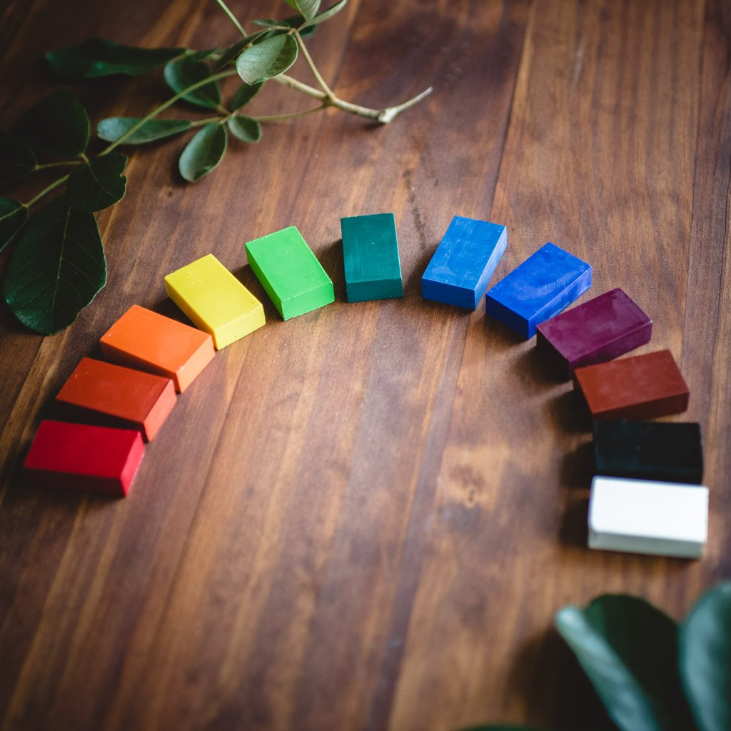 Stockmar natural beeswax crayons in a rainbow shape.