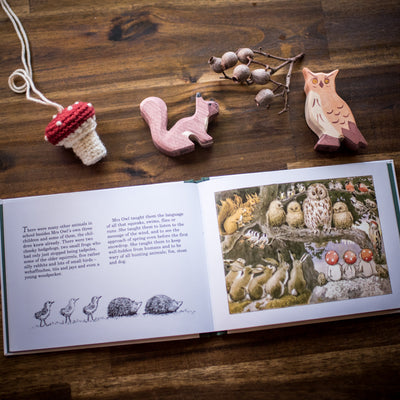 children of the forest with flat lay of sweet elm toadstool necklace and holztiger wooden animal toys
