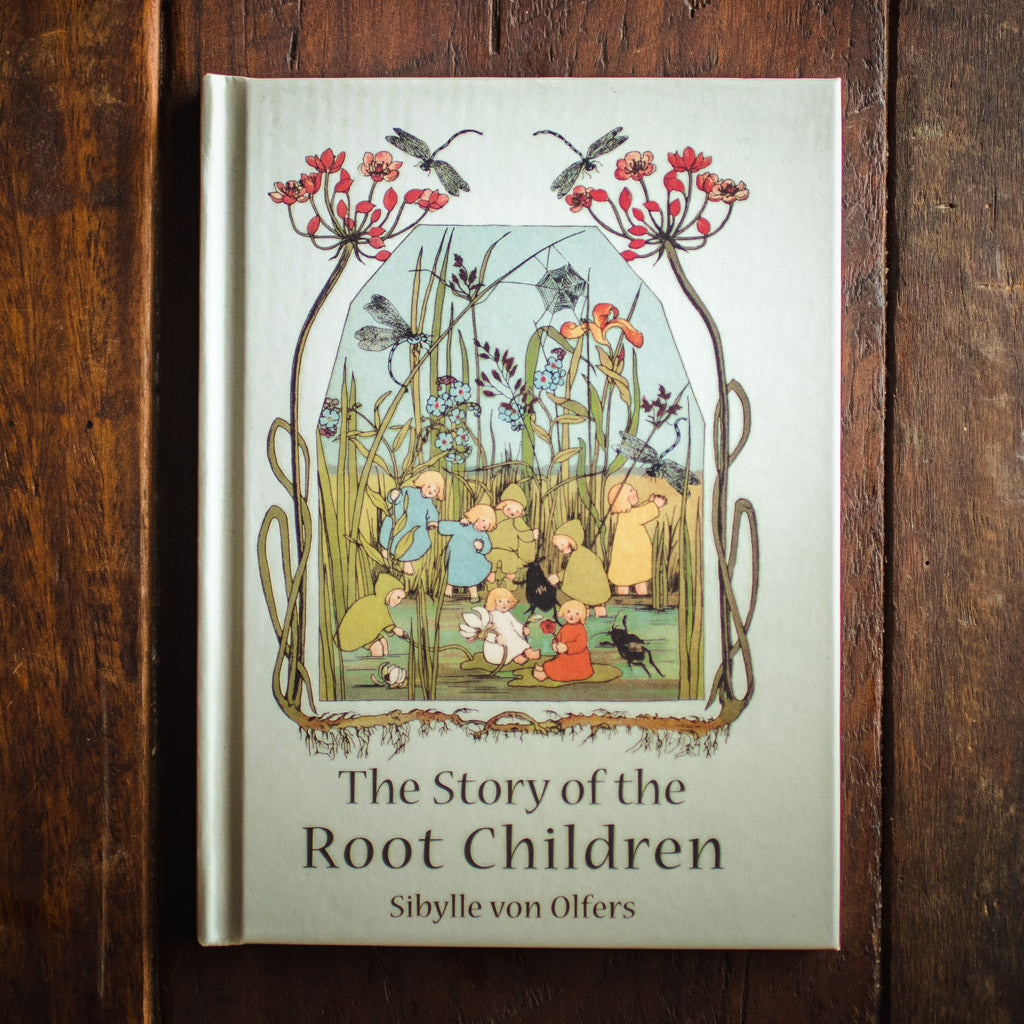Front cover of Story of the Root Children featuring the kids playing at the pond's edge.