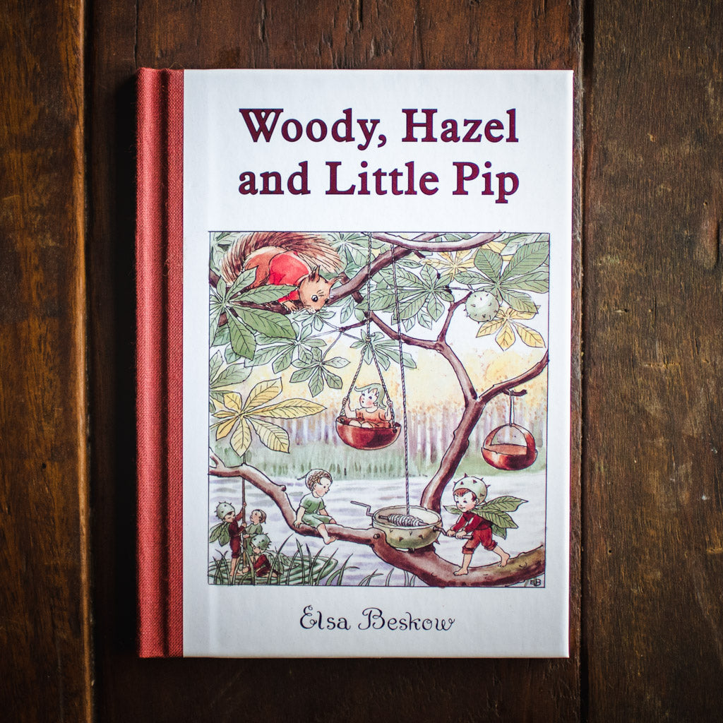 Front cover of the book Woody, Hazel and Little Pip, featuring children playing in a tree.