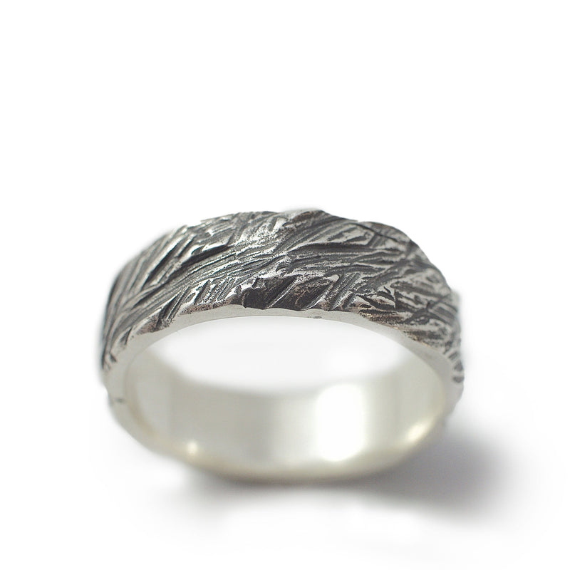 Men's ring Band carved oxid. Standing view. band silver ring with rough structure.
