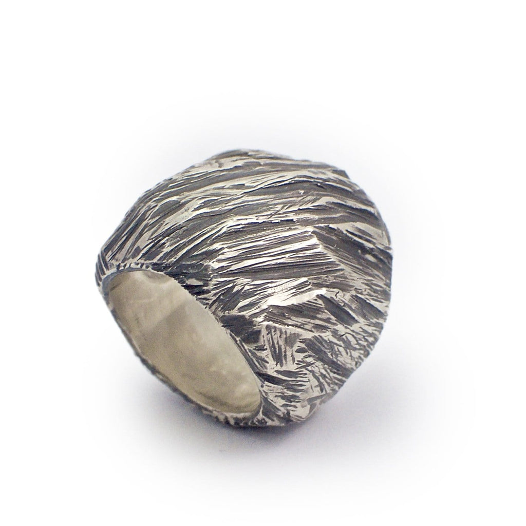 Men's ring Band carved oxid big. Standing view. Big silver ring with rough carved design.