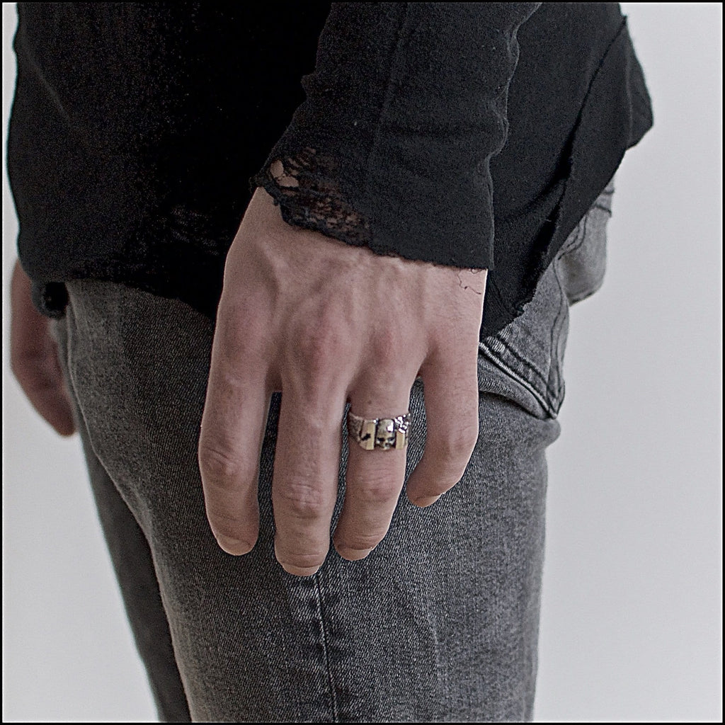 Skull ring Band carved. Shown on male hand model.