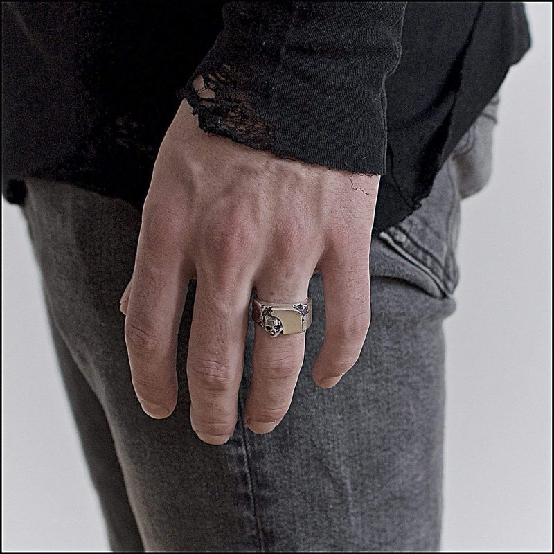 Skull ring Signet carved medium. Shown on male hand model.