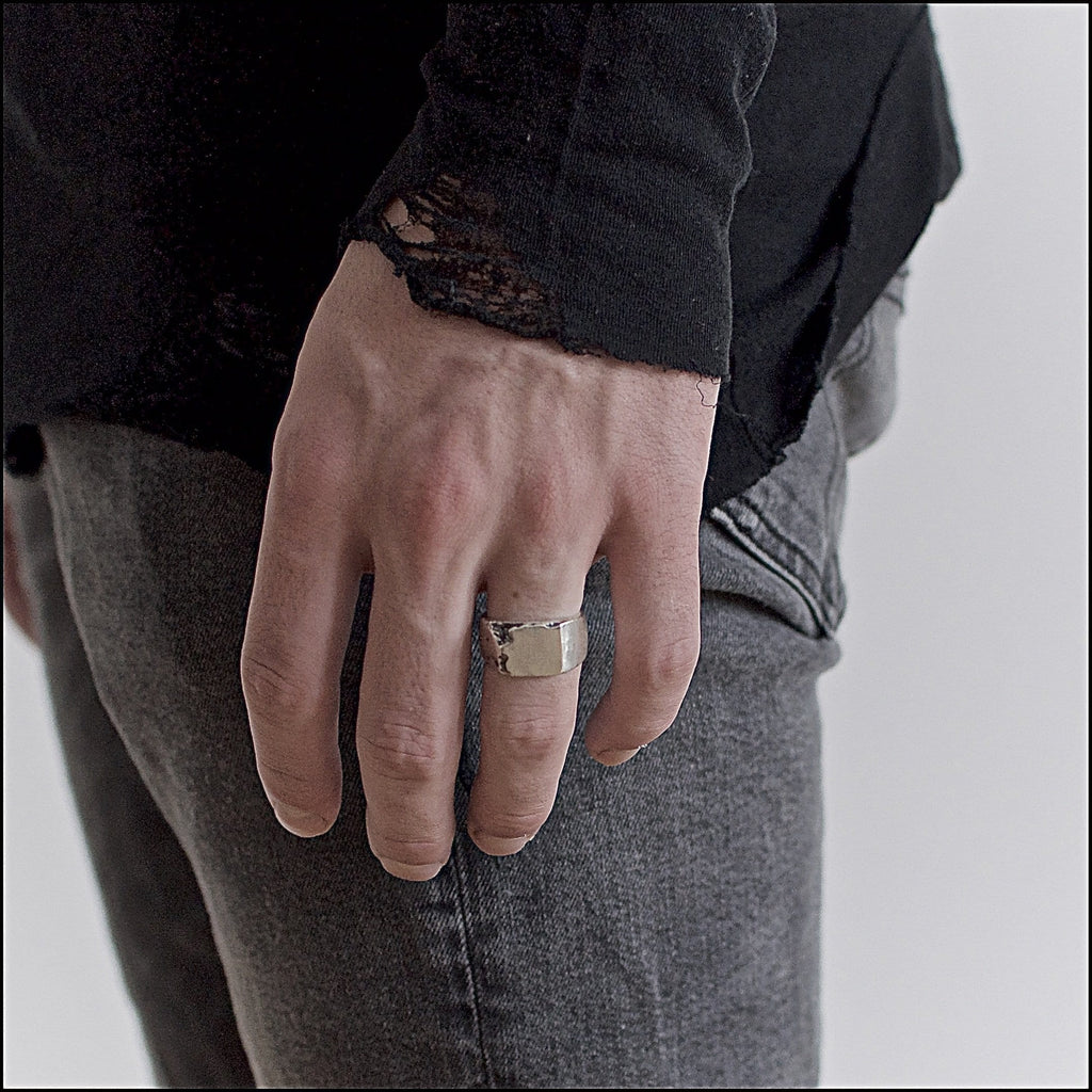Men's ring Signet classic carved. Shown on male hand model.