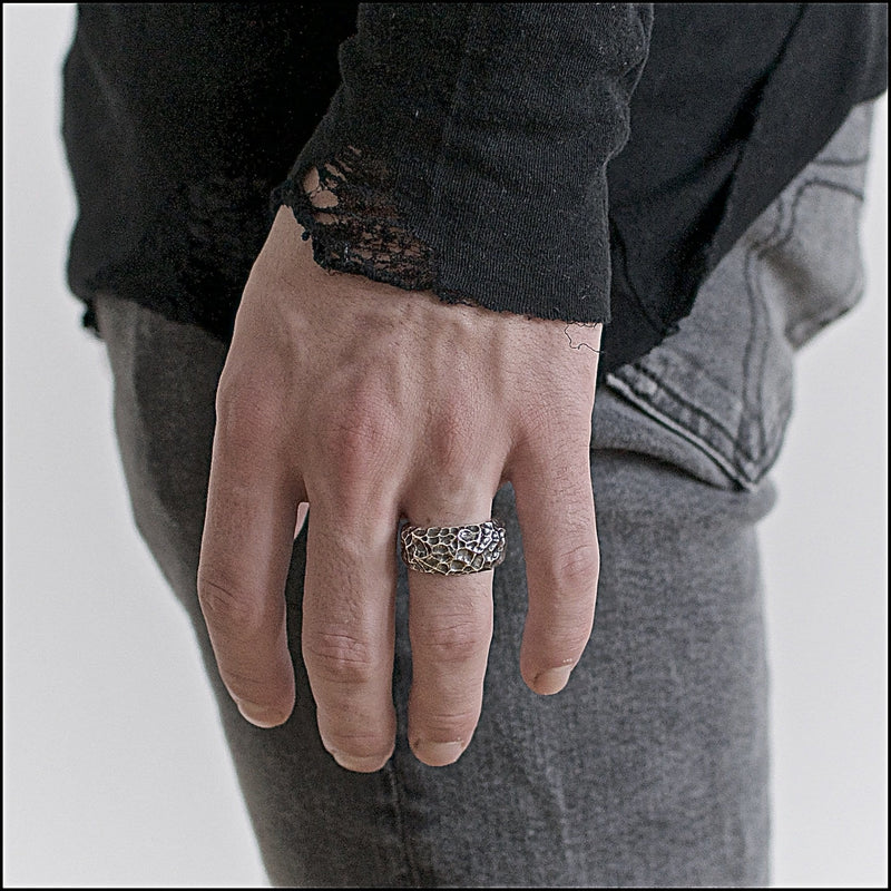 Men's ring Band carved moon. Shown on male hand model.