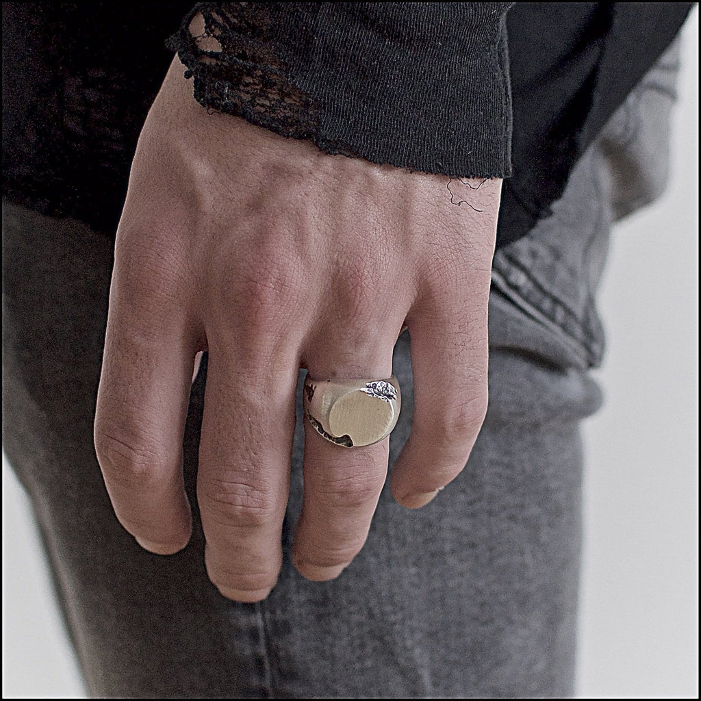 Men's ring Signet round crunch. Shown on male hand model.