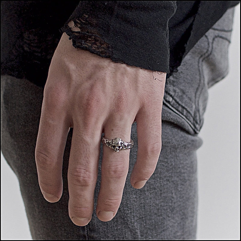 Skull ring Band thin. Shown on male hand model.