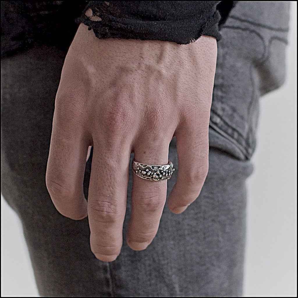 Men's ring Band moon oxid small. Shown on male hand model.