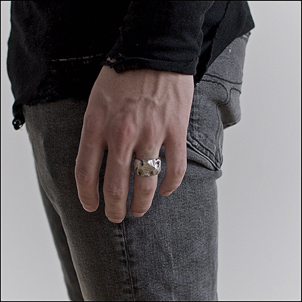 Men's ring Band carved raw. Shown on male hand model.