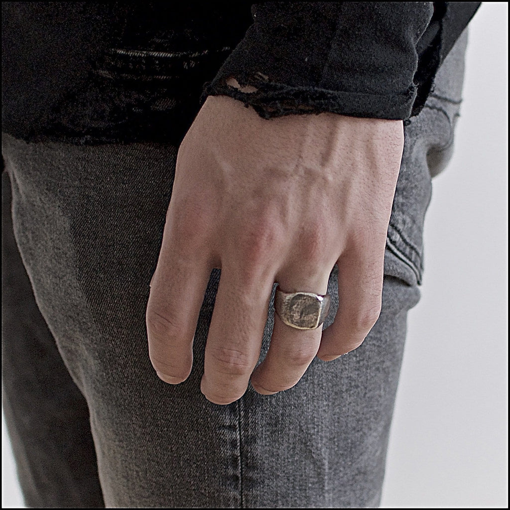Men's ring Signet rounded oxid. Shown on hand model.