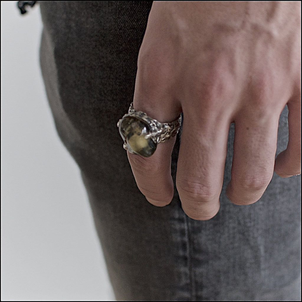 Men's ring Baltic amber green. Shown on male hand model.