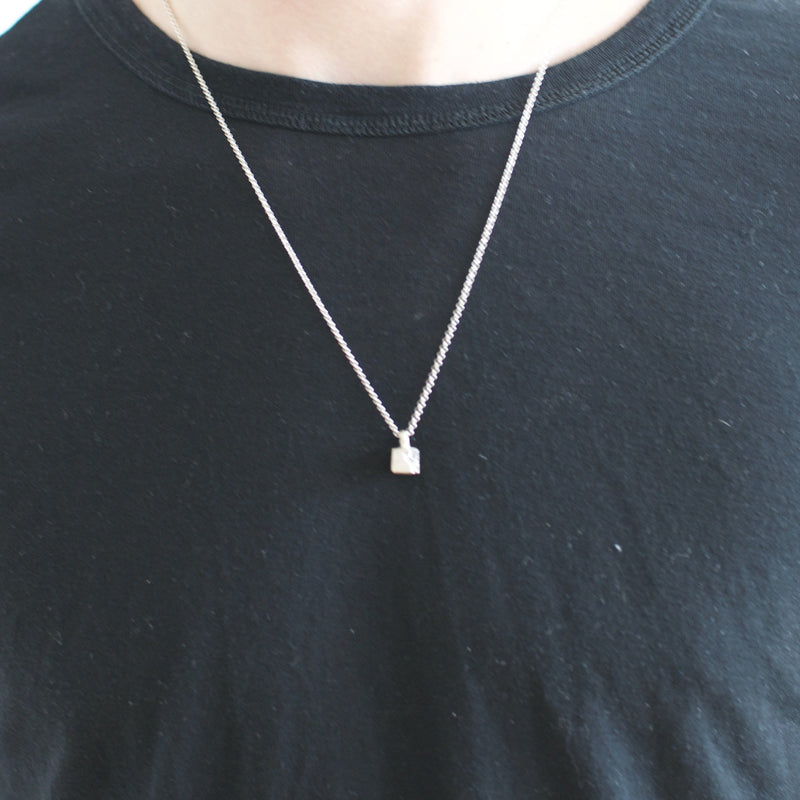 Men's necklace Pendant broken cube. Shown on male model.