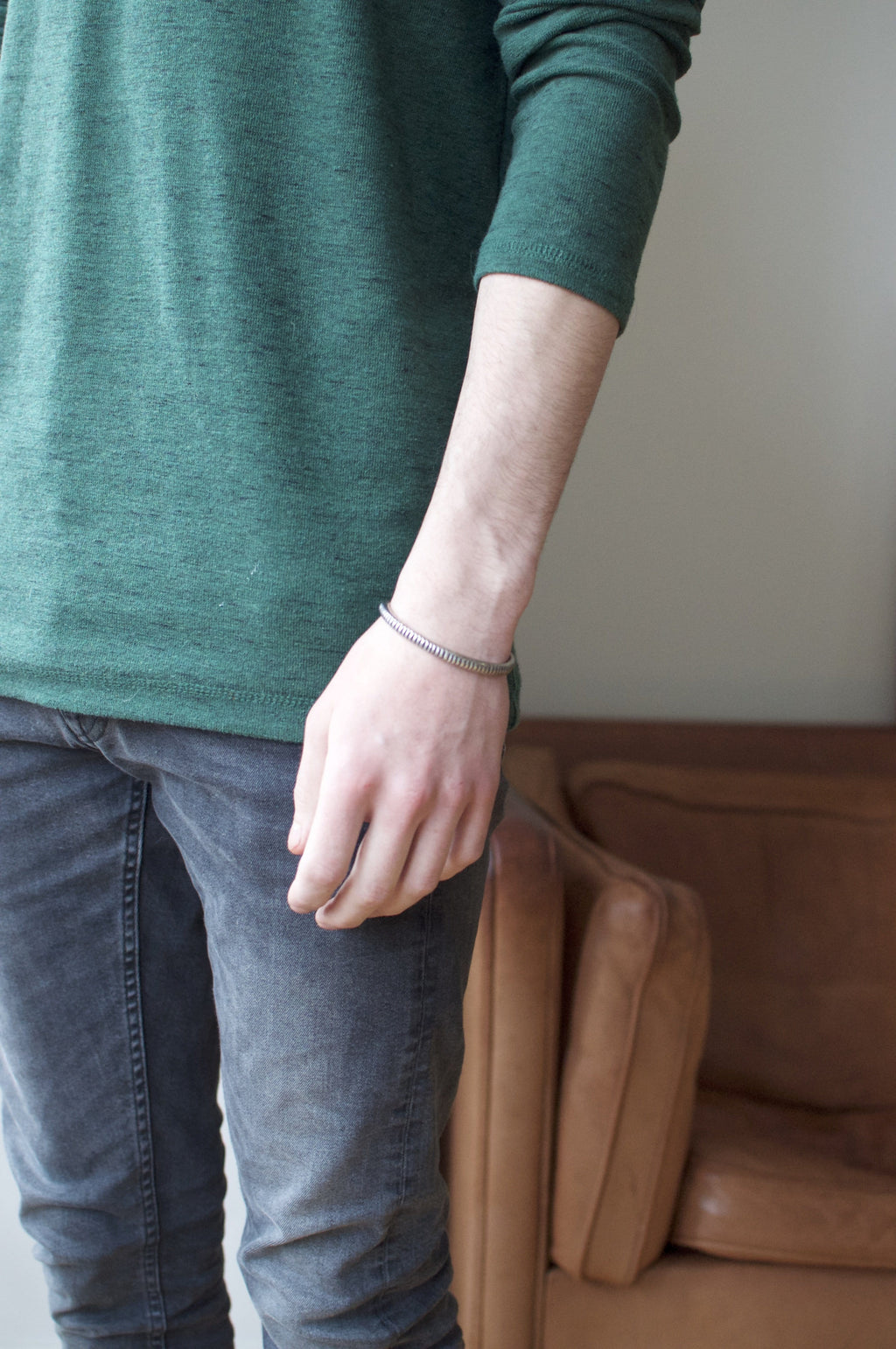 Men's bracelet Cuff classic carved. Shown on male model.
