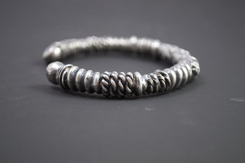 Men's bracelet Cuff twist. Side view on table.
