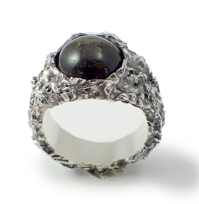 Black stone ring. Standing view.