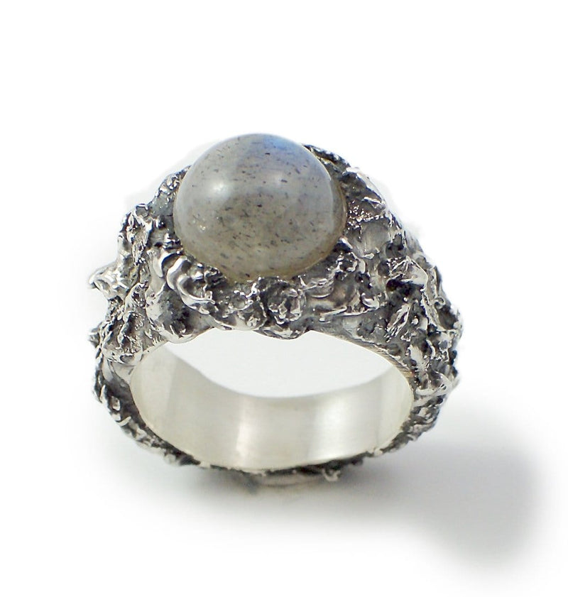Men's ring Moon stone. Standing view. Rough texture with an integrated round stone.
