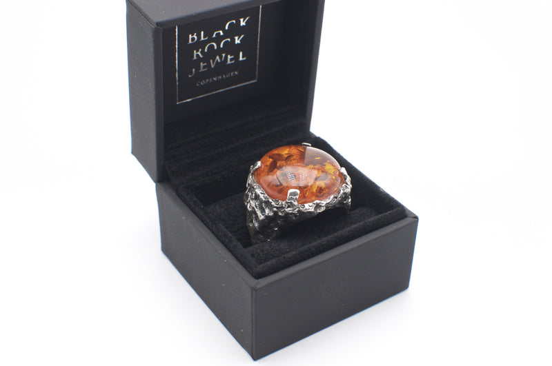 Men's signet ring Baltic amber in a box packaging