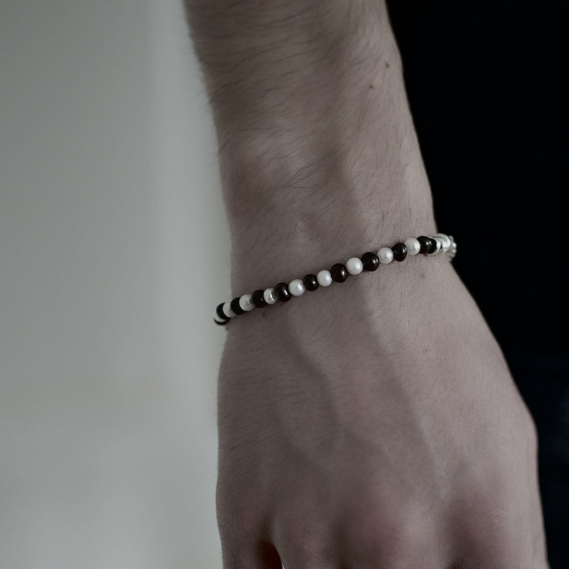 Mens bracelet with fresh water black and white pearls on model