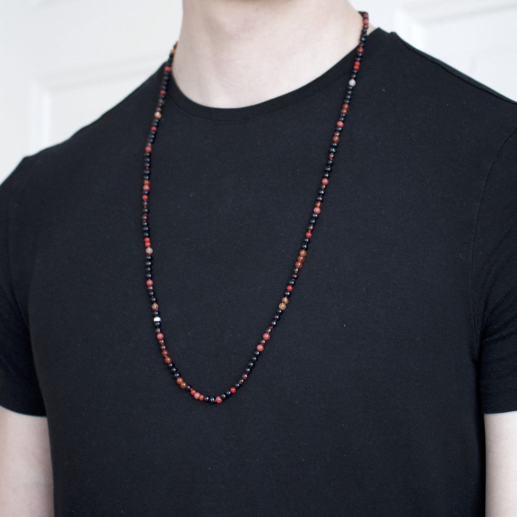 Necklace with freshwater pearls and red precious stone