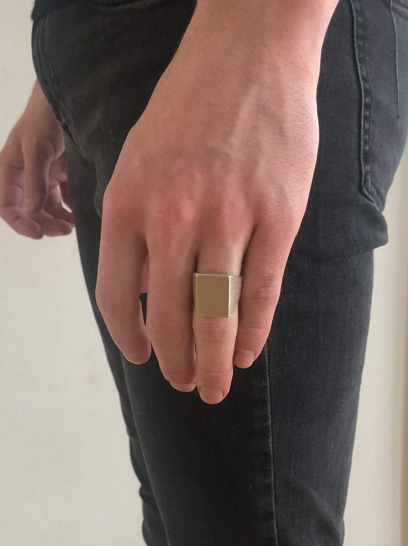 Men's ring Signet rectangular classic. Shown on male model.