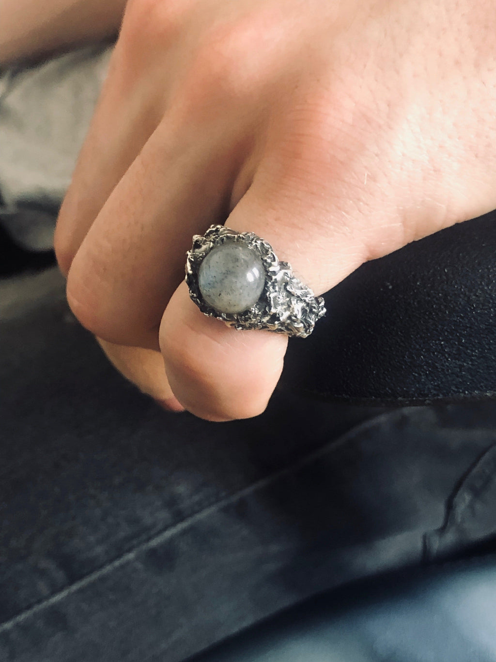 Men's ring Moon stone. Shown on male hand model.